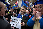 Anti Brexit pro Europe demonstrator in favour of a Peoples Vote argues with a Vote Leave protester in Westminster on the day of the 'meaningful vote' when MPs will back or reject the Prime Minister's Brexit Withdrawal Agreement on 15th January 2019 in London, England, United Kingdom.