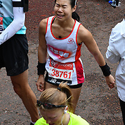 London, England, UK. 28 April 2019. Li Ping Chiam from Singapore finish the Virgin Money London Marathon at Pall Mall.