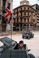 Two Ferret armoured cars of the Queen's Dragoon Guards regiment of the British army on patrol on the streets of Syria. Photograph by Terry Fincher