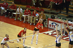 12 November 2006: Jessie Janik strikes the ball from the outside.  Other players from the left: Kasey Mollerus, Jessie Janik, Trista Humpal, and Ashten Stelken..In the final regular season home game at ISU, the Northern Iowa Panthers defeated the Illinois State Redbirds 3 game to 1. The match took place at Redbird Arena on the campus of Illinois State University in Normal Illinois.<br />