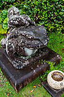 Frog Statue at Kanjizaiji - Kanjizaiji is number 40 of the 88 temples in the Shikoku Pilgrimage and has one of the Nanyo Seven Gods of Fortune or Nanyo Shichi Fukujin. Nanyo  means the southern part of Ehime. The deity of this temple is called Benzaiten - the deity of treasure and arts as well as prevents the natural disasters for people.  The temple also has an octagonal structure called the Houshuden Hakkakudou, along with frog statues as well as the famous rakan disciples statues called the Hattaihutsu Junishi Honzon.  Beneath the temple gate is a volorful and unique mandala on the ceiling.