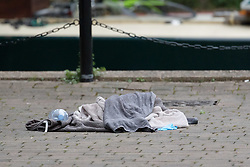 © Licensed to London News Pictures. 22/09/2018. London, UK.  Towels, water and plastic gloves at the scene in Island Row in Limehouse, Tower Hamlets, E14 where police were called after a 17 year old boy was stabbed last night at around 8:30pm..  Photo credit: Vickie Flores/LNP