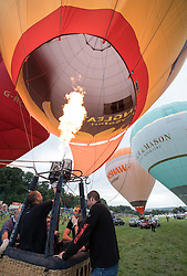 © Licensed to London News Pictures. 12/08/2016. Bristol, UK. Bristol International Balloon Fiesta 2016. Balloons are tethered as Friday morning's planned mass ascent is called off due to strong winds at flying height. The Bristol International Balloon Fiesta is Europe's largest ballooning event and takes place from Thursday 11th August – Sunday 14th August, attracting half a million people over four days. This year 150 hot air balloons will attend, taking off in mass ascents at dawn and dusk. On Thursday and Saturday evenings, 30 balloons will tether in the main arena and light up in sequence to music for the famous Night Glows. Photo credit : Simon Chapman/LNP