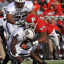 Oct 10, 2009; Piscataway, NJ, USA; Texas Southern quarterback Arvell Nelson (8) is sacked by Rutgers defensive end Jonathan Freeny (99) during first half NCAA college football action between Rutgers and Texas Southern at Rutgers Stadium.