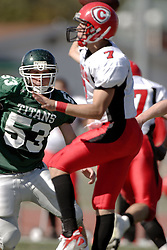 07 October 2006:Brock Collins closes in on a passing Brennan O'Boyle. The Titans of Illinois Wesleyan University started off strong with a touchdown on the 2nd play from scrimmage in the game.  The Titans led most of the way, but failed to maintain the lead in the 4th quarter giving up the decision of this CCIW conference game to the Red Men of Carthage by a score of 31 - 28. Action was at Wilder Field on the campus of Illinois Wesleyan University in Bloomington Illinois.<br />