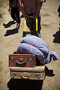 "Luggages. The yearly gathering of the Rainbow Family of Living Light took place in the  Gifford Pinchot National Forest, in the Washington State, near Portland...Rainbow Gatherings are temporary intentional communities, typically held in outdoor settings, and espousing and practicing ideals of peace, love, harmony, freedom and community, as a consciously expressed alternative to mainstream popular culture, consumerism, capitalism and mass media. These gatherings are an expression of a Utopian impulse, combined with bohemianism, hipster and hippie culture, with roots clearly traceable to the 1960s' counterculture. ..A 4-weeks road trip across the USA, from New York to San Francisco, on the steps of Jack Kerouac's famous book ""On the Road"".  Focusing on nomadic America: people that live on the move across the US, out of ideology or for work reasons."