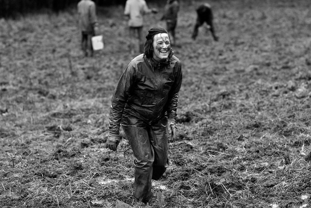 During a lighthearted break at a Crop Mob, Beth M smeared mud on her face and searched out other farmers to paint, laughing as she chased them around the field.