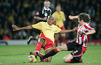 Photo: Marc Atkins.<br /> <br /> Watford v Sheffield United. The Barclays Premiership. 28/11/2006. Damien Francis (L) of Watford  & Alan Quinn of Sheffield Utd in action
