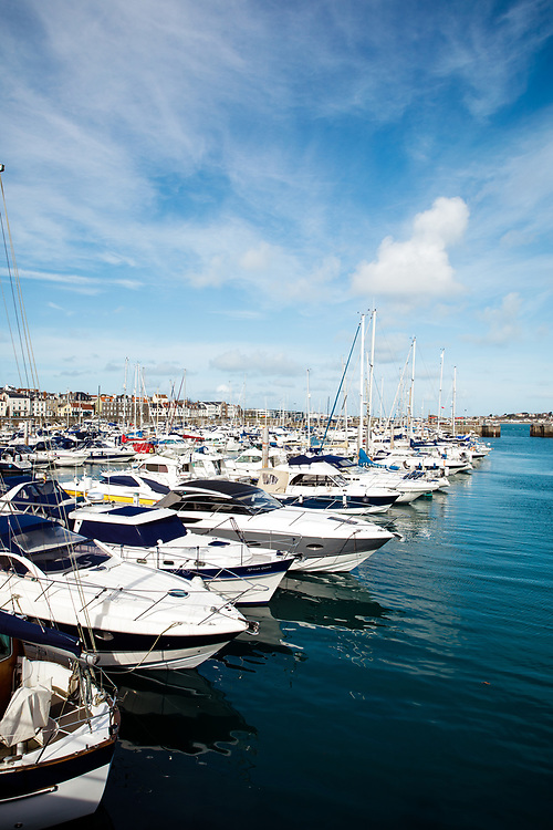 St Peter Port harbour in Guernsey on a calm sunny day