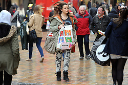 © Licensed to London News Pictures. 23/12/2013<br /> Panic Monday Christmas shoppers fight the bad weather conditions today (23.12.2013) for last minute Christmas gifts in Bromley High Street,Bromley,Greater London<br /> Photo credit :Grant Falvey/LNP