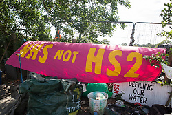 Harefield, UK. 13 July, 2020. A sign at the Harvil Road protection camp indicates the possible danger to London's water supply if HS2 drills into the chalk aquifer in the Colne Valley. This was the first camp established by environmental activists to fight against the HS2 high-speed rail link.