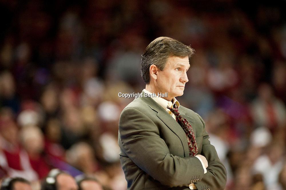 Nov 22, 2011; Fayetteville, AR, USA; Utah Valley Wolverines head coach Dick Hunsaker watches a game against the Arkansas Razorbacks at Bud Walton Arena. Arkansas defeated Utah 67-59. Mandatory Credit: Beth Hall-US PRESSWIRE