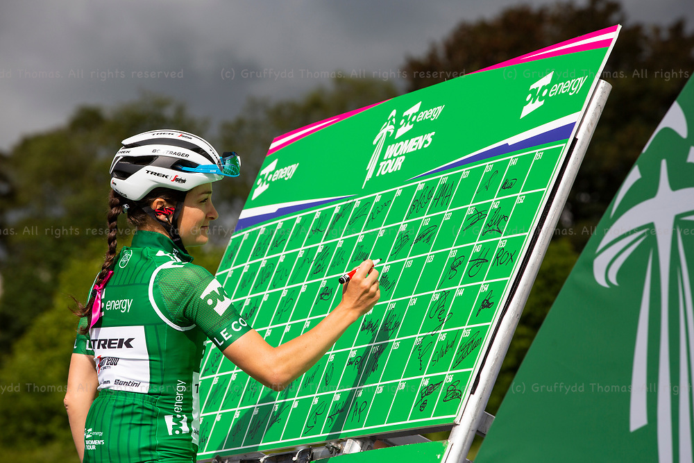 Carmarthen, Wales, UK. 15 June 2019. Lizzie Deignan of the Trek-Segafredo team signs in ahead of the start of Stage 6 of the OVO Energy Women's Tour<br /> <br /> Credit: Gruffydd Ll. Thomas