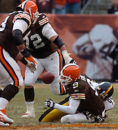 MORNING JOURNAL/DAVID RICHARD.Cleveland quarterback Charlie Frye fumbles the ball while being sacked yesterday against the Steelers.