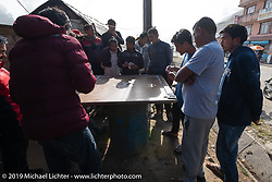 Locals gamble on the side of the road during Motorcycle Sherpa's Ride to the Heavens motorcycle adventure in the Himalayas of Nepal. Riding from Chitwan to Daman. Tuesday, November 12, 2019. Photography ©2019 Michael Lichter.