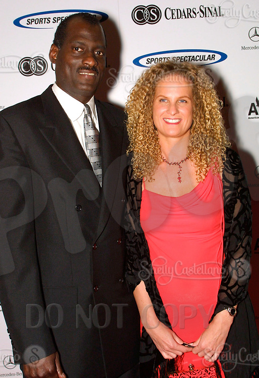 Jun 30, 2002; Los Angeles, California, USA; WNBA head coach MICHAEL COOPER with swedish girlfriend Yvonne Soderberg arrive at the 17th annual Cedars-Sinai Sports Spectacular at the Century Plaza Hotel in Century City. <br />Mandatory Credit: Photo by Shelly Castellano/ZUMA Press.<br />(©) Copyright 2002 by Shelly Castellano