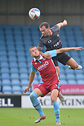 Jon Taylor of Doncaster Rovers wins a header against Bournemouth Loanee Frank Vincent (23) of Scunthorpe United during the Pre-Season Friendly match between Scunthorpe United and Doncaster Rovers at Glanford Park, Scunthorpe, England on 15 August 2020.