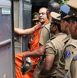 June 14, 2018 - Sri Lanka - Sri Lankan guards escort Buddhist monk Galagodaatte Gnanasara after he was sentenced to six months in jail by a magistrate in Homagama on June 14, 2018. - A firebrand Buddhist monk was sentenced to six months in jail by a Sri Lanka court June 14 for intimidating a woman whose cartoonist husband has been missing since his abduction by the military. The court in Homagama, near the capital Colombo, also fined Galagodaatte Gnanasara 1,500 rupees ($10) and ordered him to pay 50,000 rupees ($310) in compensation to Sandya Eknaligoda for abusing her in January 2016. (Credit Image: © Lahiru Harshana/Pacific Press via ZUMA Wire)