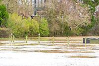 The river Avon bursts its banks just outside Stratford upon Avon Warwickshire