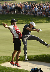 June 25, 2017 - Cromwell, CT, USA - Jordan Spieth and his caddie Michael Greller celebrate after he holed his bunker shot on the 18th green for a birdie and win over Daniel Berger during the final round of the 2017 Travelers Championship at TPC River Highlands Sunday, June 25, 2017 in Cromwell, Conn. Spieth is the first wire to wire winner since Tim Norris won in 1982 at Wethersfield Country Club. (Credit Image: © John Woike/TNS via ZUMA Wire)