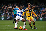 Nedum Onuoha of Queen's Park Rangers defending the ball from Fulham's Scott Parker.  Skybet football league championship match, Queens Park Rangers v Fulham at Loftus Road Stadium in London on Saturday 13th February 2016.<br /> pic by Steffan Bowen, Andrew Orchard sports photography.