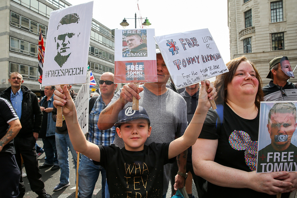 © Licensed to London News Pictures. 03/08/2019. London, UK. Supporters of Stephen Yaxley-Lennon, known as Tommy Robinson demonstrates in central London demanding to free him. Last month Tommy Robinson was given a nine-month prison sentence at Old Bailey after he was found guilty of contempt of court. <br /> <br /> **Permission granted to be photographed**<br /> <br /> Photo credit: Dinendra Haria/LNP