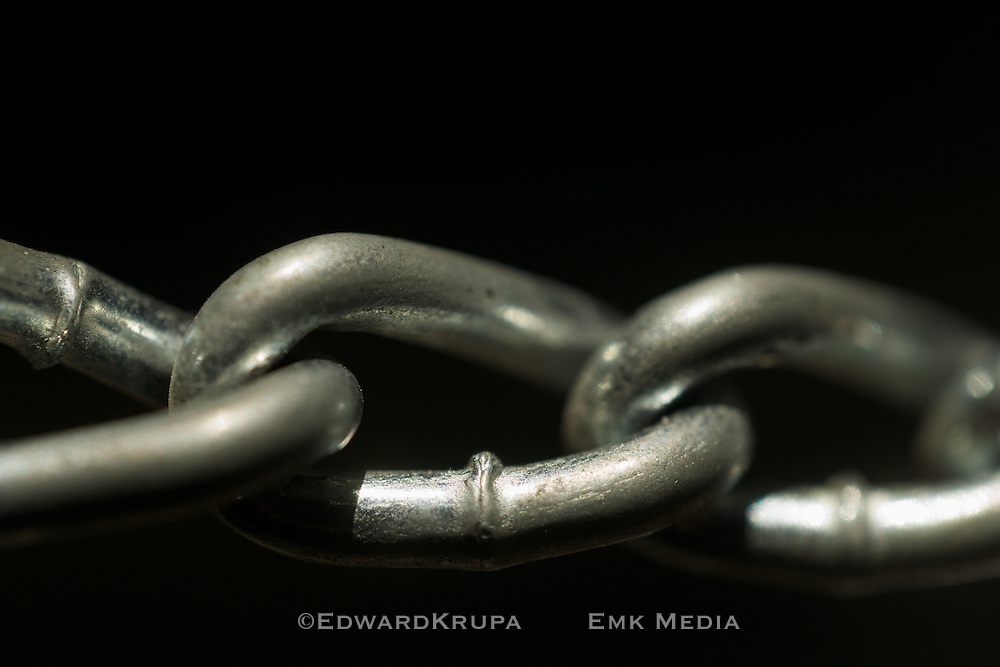 Close up of chain link on a black background.Shallow focus.