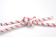 The True Lovers, or Fisherman's Knot on white background used to join two lengths of rope with two overhand (granny) knots one on each end