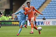 Shrewsbury Town midfielder Alex Gilliead (18) looks to release the ball  under pressure from Coventry City midfielder (on loan from Derby County Luke Thomas (23) during the EFL Sky Bet League 1 match between Coventry City and Shrewsbury Town at the Ricoh Arena, Coventry, England on 28 April 2019.