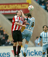 Photo: Kevin Poolman.<br />Coventry City v Sheffield United. Coca Cola Championship. 11/03/2006. <br />Sheffield United's Neil Shipperley (L) and Michael Doyle go up for the ball.