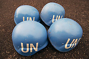 1994, Skopje, Macedonia --- Blue United Nations helmets wait to be worn by United States soldiers assigned to a United Nations observation team. --- Image by © Leif Skoogfors/CORBIS