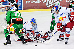 Joshua Tordjman (Red Bull Salzburg, #39) pokes a puck during ice-hockey match between HDD Tilia Olimpija and EC Red Bull Salzburg in 26th Round of EBEL league, on November 27, 2011 at Hala Tivoli, Ljubljana, Slovenia. (Photo By Matic Klansek Velej / Sportida)