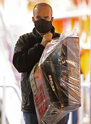 © Licensed to London News Pictures. 02/11/2020.  <br /> Crayford, UK. A man carrying a large bag with toys in. Due to the second lockdown announcement by Prime Minister Boris Johnson at the weekend the number of Christmas shopping days has been halved. Shoppers on a late night panic buying spree at a Smyths toys superstore in Kent. Photo credit:Grant Falvey/LNP