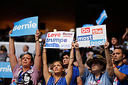 07252016 - Philadelphia, Pennsylvania, USA: Bernie Sanders supporters and Hillary Clinton supporters hold competing signs during roll call on the second day of the Democratic National Convention. (Jeremy Hogan/Polaris)