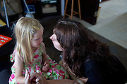 Polish mother comforting sad daughter age 32 and 4. Zawady Central Poland