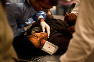 """November 22, 2011 – Cairo, Egypt - A protestors with a rubber bullet wound in his eye receives medical care at field hospitals set up around Tahrir square to deal with the increasing number of injuries. The police have been targeting eyes for days and many have become blind. Most suffer from the extreme side effects of the type of tear gas used by the police, while others have bullet wounds from real and rubber bullets. Protest organizers called today for a """"million man march,"""" thousands turned out. Egypt's military leader promised a faster transition to civilian rule, saying Tuesday that presidential elections will be held by the end of June 2012. But the major concession was immediately rejected by tens of thousands of protesters in Cairo's Tahrir Square who responded with chants of """"leave, leave"""" now. Photo credit: Trevor Snapp"""