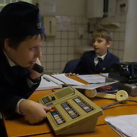 Boys work at the Huvosvolgy station of the Children's Railway in the Buda Hills in Budapest, Hungary on November 13, 2014. ATTILA VOLGYI