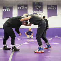 Yele Aycock, left, returning state champion and Rhys Sellers, district runner up and seeded #2 in the state, prep for the upcoming New Mexico Athletic Association state wrestling tournament Tuesday afternoon at Miyamura High School. Miyamura High School is sending 12 boys and 7 girls to compete at the New Mexico Athletic Association state wrestling tournament this weekend at the Santa Ana Star Center in Rio Rancho.