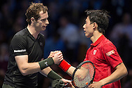 Andy Murray of Great Britain is congratulated by Kei Nishikori of Japan after winning his match (6-7) (6-4) (6-4)  during day four of the Barclays ATP World Tour Finals at the O2 Arena, London, United Kingdom on 16 November 2016. Photo by Martin Cole.