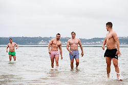 Andy Uren and Dan Thomas look on as Bristol Rugby take part in a morning after game recovery session in the sea - Rogan/JMP - 29/10/2017 - RUGBY UNION - Jersey Marine Lake - St Helier, Jersey - Jersey Reds v Bristol Rugby - Greene King IPA Championship.