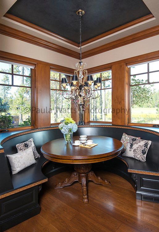 classic and elegant breakfast seating with black accents and chandelier
