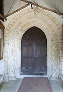 Norman doorway arch village parish church of Saint John the Baptist, Chirton, Vale of Pewsey, Wiltshire, England, UK