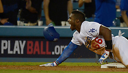 October 6, 2017 - Los Angeles, California, U.S. - Los Angeles Dodgers' Yasiel Puig rects after a triple against the Arizona Diamondbacks in the seventh inning of a National League Divisional Series baseball game at Dodger Stadium on Friday, Oct. 06, 2017 in Los Angeles. Los Angeles Dodgers won 9-5. (Photo by Keith Birmingham, Pasadena Star-News/SCNG) (Credit Image: © San Gabriel Valley Tribune via ZUMA Wire)