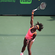 Serena Williams, of the United States, serves the ball to Monica Niculescu, of Romania, during their match at the Miami Open tennis tournament on Saturday, March 28, 2015 in Key Biscayne, Florida. (AP Photo/Alex Menendez)