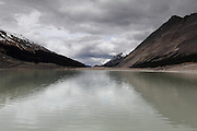 A small grey glacial lake at the foot of the Athabasca Glacier, in the Jasper National Park, along the Icefields Parkway