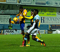 Armand Gnanduillet of Blackpool is beaten to the ball by Krystian Pearce of Mansfield Town<br /> <br /> Photographer James Williamson/CameraSport<br /> <br /> The EFL Sky Bet League Two - Mansfield Town v Blackpool - Tuesday 22nd November 2016 - One Call Stadium - Mansfield<br /> <br /> World Copyright © 2016 CameraSport. All rights reserved. 43 Linden Ave. Countesthorpe. Leicester. England. LE8 5PG - Tel: +44 (0) 116 277 4147 - admin@camerasport.com - www.camerasport.com