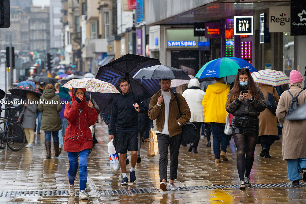Edinburgh, Scotland, UK. 3 October, 2020. An amber rainfall warning for the east of Scotland did not deter many shoppers from walking along Princes Street in Edinburgh today. Persistent heavy rain fell throughout the morning and afternoon. Iain Masterton/Alamy Live News