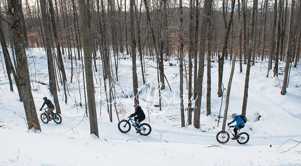 """Highlands 50 year history has seen skiers going downhill in years past to current day fat bike riders going uphill on Saturday as they head out on the groomed trails during the 50 year """"then and now"""" anniversary celebration.   (Karen Bobotas/for the Laconia Daily Sun)"""