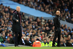 West Ham United manager David Moyes (left) and Manchester City manager Pep Guardiola