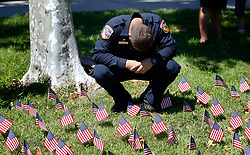 September 11, 2017 - San Diego, California, USA - Fire fighter Steven Hay from San Diego County Fire, Cal Fire, bows his head to say a prayer at Grossmont College for the fire fighters that lost their lives during the 9/11 attacks in New York. (Credit Image: © Nelvin C. Cepeda/San Diego Union-Tribune via ZUMA Wire)
